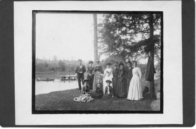 Unidentified group of men and women beside the Thames River, London, Ontario