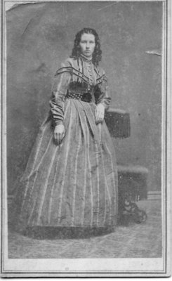 Portrait of an unidentified woman with shoulder length, dark ringlets, London, Ontario