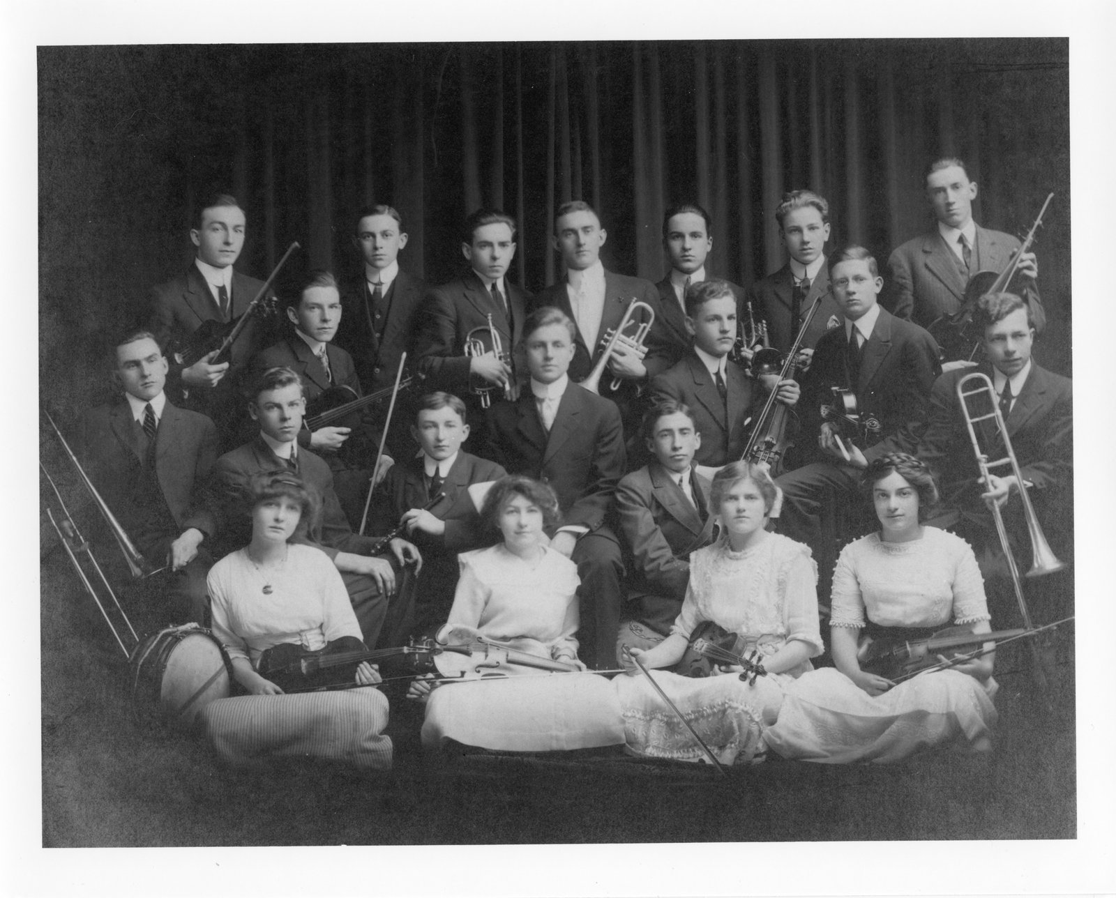 A co-ed group of musicians. The women in the front row play only stringed instruments. <br>Courtesy the London Public Library.