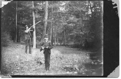 John(?) and Frank Hood, shooting in the woods near London, Ontario