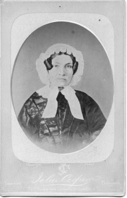 Portrait of an unidentified dark haired woman in a lace edged bonnet, London, Ontario.