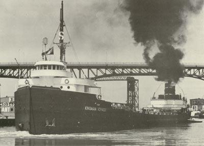 KINSMAN VOYAGER bound up Cleveland's Cuyahoga River.
