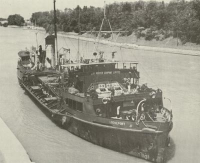 Porter's steam dredge LOCKEPORT upbound into Lock One of the Welland Canal