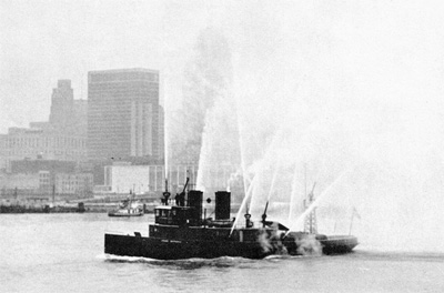 Detroit firetug JOHN KENDALL gives a farewell salute to SOUTH AMERICAN