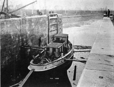 ESCORT being rebuilt in a lock on the third Welland Canal