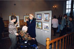 New Year's Levee.  1997.   Marie Clements admiring pictures at the Art Show.