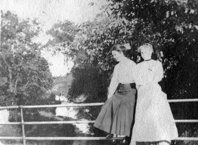 Two women posed on railing