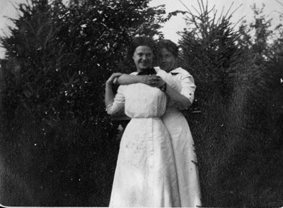 Two women in white dresses