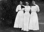 Three women in white dresses