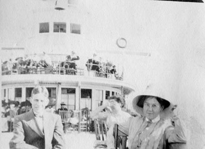 Man and woman seated on deck