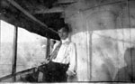 Young man posed on board ship