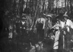 Group of women posed in wooded area