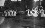 Group of young women dancing on lawn