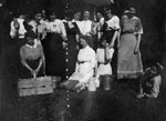 Group of women posed in theatrical performance