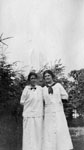 Two ladies dressed in white