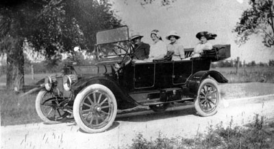 Man and three women in car