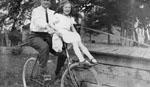 Man and girl on bike