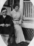 Young man and woman sitting on porch steps