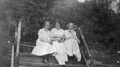 Three young women sitting on steps