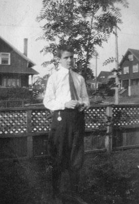 Adolescent boy in garden