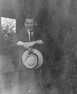 Man holding hat