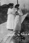 Two ladies on sidewalk