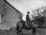 "Harold Boyce Earl on Dobbin at ""Rose Hill"" farm"
