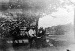"Gussie Willmott and Cousin Dorothy Willmott under apple tree at ""Rose Hill"" farm."