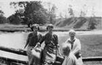 """Connie Hunter, Aggie, Gussie and Fred Willmott at bridge in flats, """"Rose Hill"""" farm."""