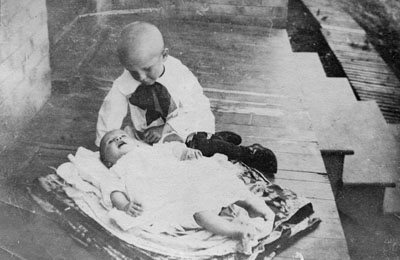 Young child looking at baby