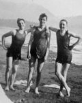 Three young men in bathing suits