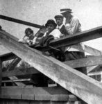 Man and three women on a bridge