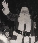 Santa Claus waves to the crowd at the 1953 Milton Santa Claus Parade