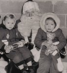 Santa Claus holding Susan Carruthers and friend