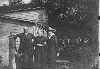 William J. Armstrong Sr., his mother Isabella and unknown lady.
