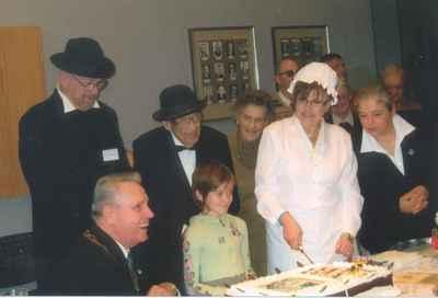 New Years Levee, 2007. Mirella Marshall cutting the anniversary cake.