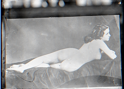 Nude figure reclining