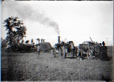 Workers on Hay Wagon; Man on Tractor; Man-Lady-Child