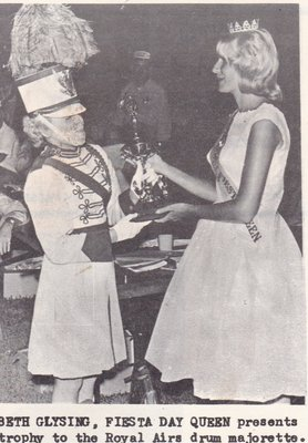 Fiesta Day Queen Presents Trophy To The Royal Airs Drum Majorette