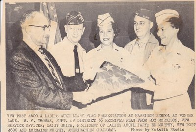 Ladies Auxiliary Presenting Flag At Harrison School