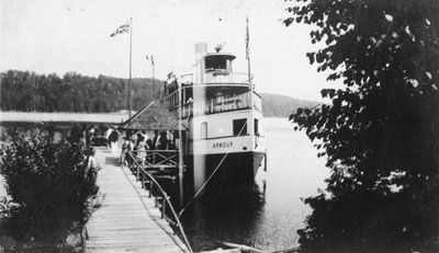 Armour Steamboat Sitting at a Dock with People Boarding, circa 1930