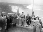 Rainbow Bridge - Official opening to traffic ceremony - raising of American and Canadian flags at the International Boundary Line