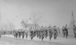 Band and soldiers marching in parade in front of Holy Trinity Anglican Church Chippawa