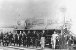 Unidentified Men Standing by a Steam Train