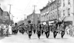 Soldiers in a military marching band parading through Hamilton
