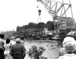 Raising sections of the Port Robinson Bridge over the Welland River