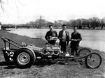 Boys standing by a Drag Racer with Chippawa Creek in the background