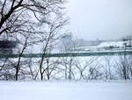 Brink of Horseshoe Falls & Goat Island from upriver in winter