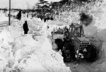 Snow plow clearing a path through the snow - Blizzard of 77