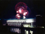 Fireworks light up the sky over the Robert Moses Power Generating Station Niagara Falls New York, viewed from Canada